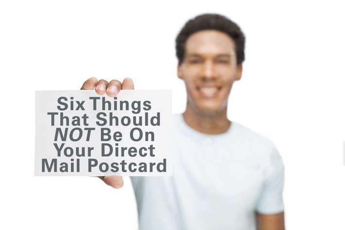 Image of Man Holding Postcard